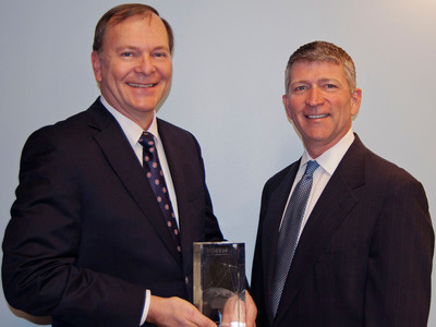 Richard Hadsall receives Lifetime Achievement Award from MTN's CEO Errol Olivier.  (PRNewsFoto/MTN Satellite Communications)