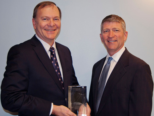 Richard Hadsall receives Lifetime Achievement Award from MTN's CEO Errol Olivier.  (PRNewsFoto/MTN ...