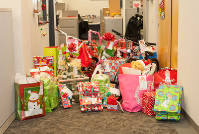 Piles of gifts line the halls of NBTY Corporate headquarters as they wait to be picked up by the Salvation Army.  (PRNewsFoto/NBTY, Inc.)
