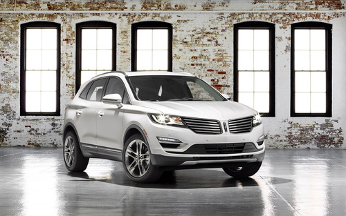 The 2015 Lincoln MKC small premium utility will go on sale next year with a suggested retail price starting at $33,995, including destination and delivery.  (PRNewsFoto/Lincoln)