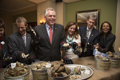 Governor McAuliffe and the First Lady Shucking Oysters