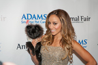 Melissa Gorga struts the red carpet at the Animal Fair Paws for Style Event sponsored by Adams Pet Care. More than $60,000 was raised for the Humane Society of New York. For more information, visit www.smarterpetcare.com. (PRNewsFoto/Adams Pet Care)
