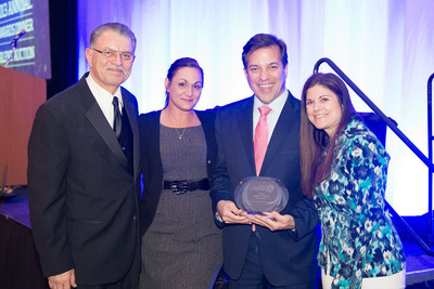 Liberty Power was presented with the award for the 2013 Minority Business Enterprise (MBE) of the Year award by the Northwest Minority Supplier Development Council (MSDC), Inc.(R) on March 8 in Seattle, WA. From left to right: Fernando Martinez, President, Northwest Minority Supplier Development Council; Angelina Mariani, Senior Sales Support Analyst, Liberty Power; Nelson Reyneri, VP, Key Accounts and External Affairs, Liberty Power; and Shay Reed, Costco Energy Buyer. // Liberty Power recibio el premio para 2013 Minority Business Enterprise (MBE) (Empresa Propiedad de Minorías (MBE) del Ano 2013) otorgado por el Northwest Minority Supplier Development Council (MSDC), Inc.(R) el 8 de marzo en Seattle, Washington. De izquierda a derecha: Fernando Martinez, Presidente del Northwest Minority Supplier Development Council; Angelina Mariani, Analista Ejecutiva de Asistencia de Ventas, Liberty Power; Nelson Reyneri, Vicepresidente de Cuentas Clave y Asuntos Externos, Liberty Power; Shay Reed, Compradora de Servicios de Energia de Costco.  (PRNewsFoto/Liberty Power)