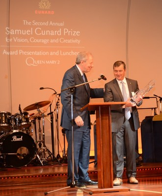 Onboard Cunard's flagship, Queen Mary 2, John Risley, recipient of the Second Annual Samuel Cunard Prize for Vision, Courage and Creativity accepts the award on board from last year's honoree, Jim Irving.