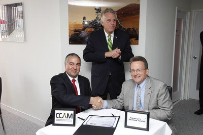 Virginia Governor Terry McAuliffe (back) oversees the agreement signed by Commonwealth Center for Advanced Manufacturing (CCAM) President & Executive Director Joseph Moody (seated, left) and Aerojet Rocketdyne President Warren Boley (right). (PRNewsFoto/CCAM)