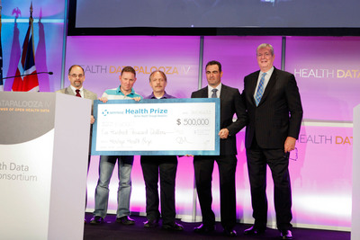 Team POWERDOT Accepts $500,000 Award from Mark Wagar, President of Heritage Medical Systems.  (PRNewsFoto/Heritage Provider Network, Inc.)