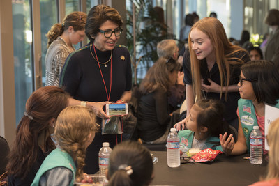"""Girl Scouts of the USA Interim CEO, Sylvia Acevedo, left, and Project Mc2 cast member, Belle Shouse, right, trade STEM stories with local Girl Scouts at the """"She Rules: STEM"""" event at Netflix headquarters in Los Gatos, Calif., Tuesday, Oct. 4, 2016. Girl Scout troops representing Girl Scouts of Northern California met with real-world STEM experts to encourage the pursuit of STEM career paths for young girls."""