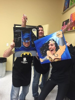 Veteran and WWP Alumnus Tim Stroud (left) was Batman for just a moment at the couples painting event.