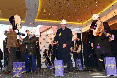 Former Cleveland Browns quarterback, Bernie Kosar, Chairman of Hard Rock international, Jim Allen, Chairman of Hard Rock Rocksino Northfield Park, Brock Milstein and President of Hard Rock Rocksino Northfield Park, Jon Lucas (L-R) conduct the legendary guitar smash grand opening of Hard Rock Rocksino Northfield Park on Wednesday, Dec. 18, 2013 in Northfield, OH. (Photo by Jason Miller/Invision for Hard Rock International/AP Images). (PRNewsFoto/Hard Rock International) (PRNewsFoto/HARD ROCK INTERNATIONAL)