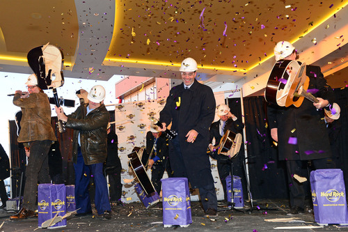 Former Cleveland Browns quarterback, Bernie Kosar, Chairman of Hard Rock international, Jim Allen, Chairman of Hard Rock Rocksino Northfield Park, Brock Milstein and President of Hard Rock Rocksino Northfield Park, Jon Lucas (L-R) conduct the legendary guitar smash grand opening of Hard Rock Rocksino Northfield Park on Wednesday, Dec. 18, 2013 in Northfield, OH. (Photo by Jason Miller/Invision for Hard Rock International/AP Images).  (PRNewsFoto/Hard Rock International)