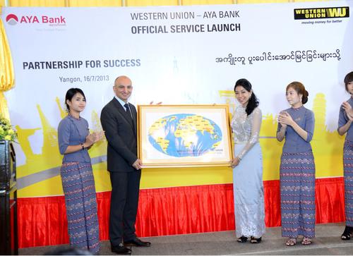 Chris Cruzado, regional vice president, Oceania & Indochina, Western Union, presents the Western Union world map during the launching ceremony in Yangon, Myanmar.  (PRNewsFoto/Western Union)