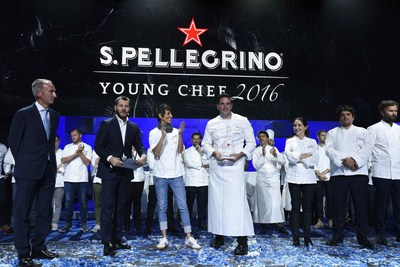 U.S. Chef Mitch Lienhard of Manresa restaurant in California is crowned S.Pellegrino Young Chef 2016--winner of the global culinary event hosted by S.Pellegrino Sparkling Natural Mineral Water--in Milan on October 15, 2016, alongside his Mentor Chef Dominique Crenn. (Photo courtesy of S.Pellegrino)