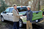 Will Telligman of the Southeastern Lumber Manufacturers Association hands over the keys to a new 2015 Ford F150 to Wood, Naturally Build and Design Sweepstakes winner Joel Harper, owner of Atlanta-based Leisure Time Decks.(Photo Credit: Jason Braverman)