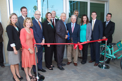 LA City Councilman Mike Bonin and Aimco Chief Administrative Officer Miles Cortez are joined by representatives from the Department of Housing and Urban Development, the Housing Authority of the City of LA, the Department of Water and Power, and the Aimco team for the official ribbon cutting to mark the grand opening of Lincoln Place Apartments in Venice, CA. (PRNewsFoto/Aimco)
