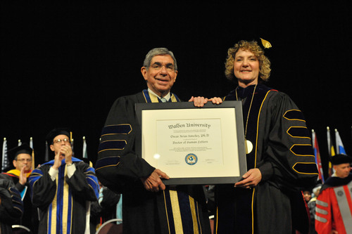 Dr. Oscar Arias Sanchez, former president of Costa Rica and 1987 Nobel Peace Prize Laureate, was presented with a Doctor of Humane Letters, honoris causa, by Walden University president Dr. Cynthia G. Baum at Walden's 48th Commencement Ceremony on Saturday, Aug. 25. in Minneapolis.  (PRNewsFoto/Walden University)