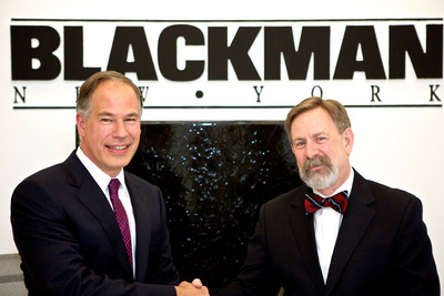 (R-L) David Krakoff, President of the Americas Sales Division for TOTO USA, and Robert Mannheimer, President and CEO of Blackman Plumbing Supply, ink landmark distribution agreement for the Northeast region of the U.S.