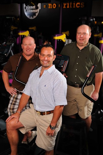 Newly named Planet Fitness chairman Marc Grondahl (right) with the company's other owners -- his brother ...