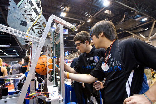 FIRST(R) Robotics Competition students program robots to run autonomously, or control them with a gaming ...