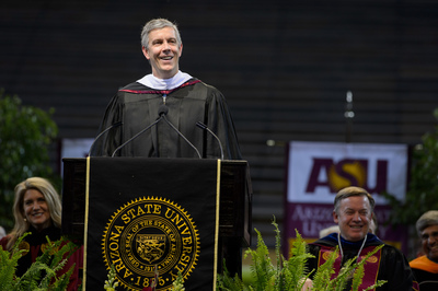 U.S. Secretary of Education Arne Duncan addressed thousands of graduating students during Arizona State University's 2014 undergraduate commencement, encouraging them to pay it forward and be change agents. (PRNewsFoto/Arizona State University)