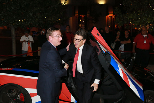 British Consul General Andrew Millar greets Governor Rick Perry as he arrives in the GREAT-branded McLaren 12C.  ...