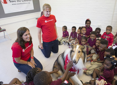 """Save the Children Animal Ambassador Lassie delights children at a Save the Children """"Prep Rally"""" at the Kingsley House Head Start Program in New Orleans. Photo by Lee Celano/Getty."""