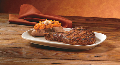 Try LongHorn SteakHouse's Outlaw Ribeye, a juicy, 18 oz. bone-in steak served with LongHorn's signature sweet potato.  (PRNewsFoto/LongHorn Steakhouse)