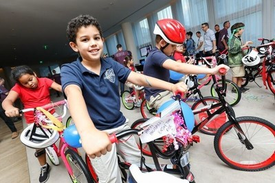 Children from the Boys and Girls Club of South Beach test their new bikes.