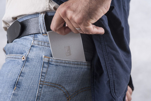 SLAB Magic Travel Wallet is extremely slim and fits comfortably in pockets without bulkiness.  (PRNewsFoto/SLAB)