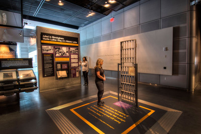"""Now on display at the Newseum, a casting of the original jail cell door behind which the Rev. Martin Luther King Jr. was confined after his April 1963 arrest for leading nonviolent protests in Birmingham, Ala. It was in this cell that the civil rights leader penned his historic letter, """"Letter From Birmingham Jail,"""" defending civil disobedience. Credit: Maria Bryk/Newseum.  (PRNewsFoto/Newseum)"""