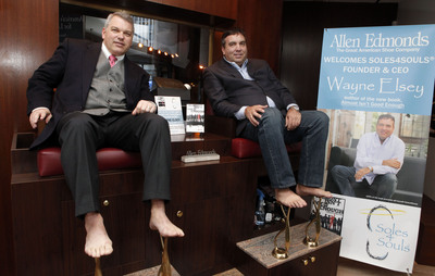 Allen Edmonds CMO Colin Hall, left, and Wayne Elsey, author and founder of Soles4Souls, pose barefoot at the Allen Edmonds store in New York, to raise awareness of a 21-day shoe collection drive benefiting Soles4Souls, a charity that facilitates the collection and distribution of shoes to people in need around the world. The drive, which begins Monday, Feb. 21, 2011, is being held at all Allen Edmonds stores and 150 select authorized dealers nationwide (Jason DeCrow/AP Images for Allen Edmonds).