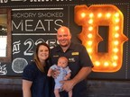 Owner/Operator Erik Forrest celebrates with his family the Dickey's grand opening in Mesa.