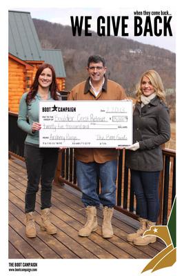 Boot Girls Meghan McDermott and Gwen Lammers Present Boulder Crest Retreat Founder, Ken Falke, with $25,000 Donation for Retreat's Archery Range.  (PRNewsFoto/The Boot Campaign)