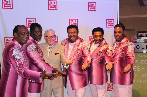 Art Van Elslander strikes a classic pose with Dennis Edwards (fourth from the right) and The Temptations Review at the Grand Opening Gala at Art Van Furniture's first store in Chicagoland on July 18, 2013.  (PRNewsFoto/Art Van Furniture, Charlie Cooper/Art Van Furniture)