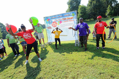 """Grammy Award-winning artist and Boys & Girls Club alum Ne-Yo joins Olympic gold medalists Jackie Joyner-Kersee and Gail Devers, and radio host Griff in a hula hoop competition during a field day event in Atlanta on Saturday, September 7. The event kicked off Boys & Girls Clubs of America's """"Day for Kids"""" which invites adults to relive their childhood to help change the lives of kids in need. The nationwide initiative, supported by Lunchables, features hundreds of events at local Boys & Girls Clubs nationwide in September. (PRNewsFoto/Boys & Girls Clubs of America) (PRNewsFoto/BOYS & GIRLS CLUBS OF AMERICA)"""