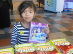CHLA patient receiving gift from Vallarta Supermarkets