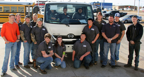 Students in Canadian Valley Technology Center's Diesel Technology program in Oklahoma City pose with their new Hino cab over engine truck. Hino donated the truck for student repair use after the program lost three diesel trucks in the May 31, 2013 tornado in El Reno. (PRNewsFoto/Hino Trucks) (PRNewsFoto/HINO TRUCKS)