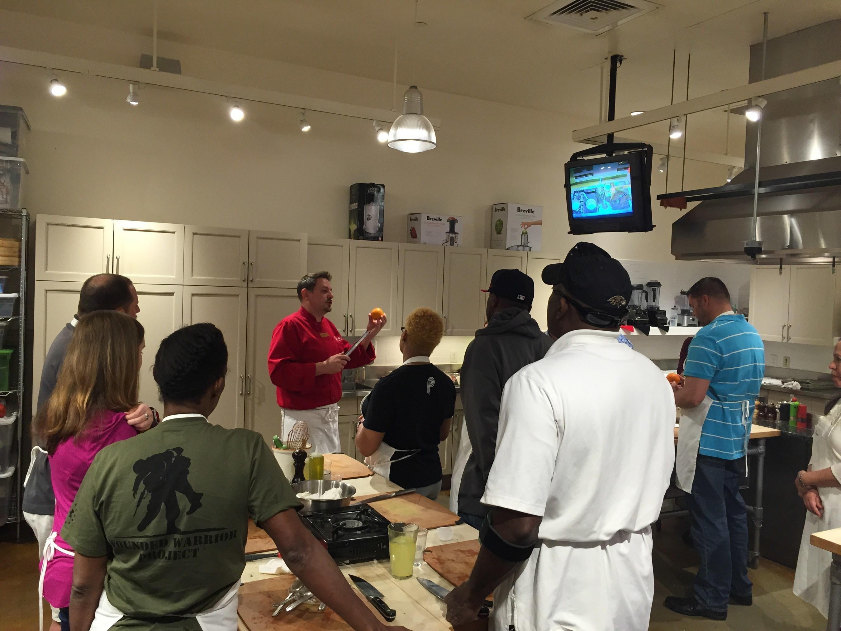 Wounded veterans and their guests learn Greek culinary skills.