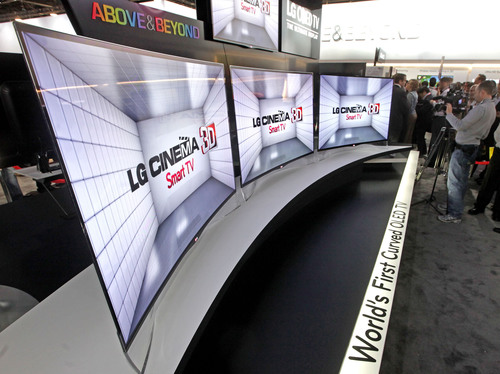 Global technology leader LG Electronics shows visitors its first curved OLED TV at the 2013 Consumer Electronics Show in Las Vegas.  (PRNewsFoto/LG Electronics)