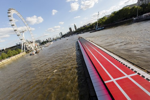 Bolt on a boat: To celebrate a summer of sport and to mark one month before his arrival in Rio, Virgin Media brought speed superstar Usain Bolt to the Thames. The river was transformed with a giant 100m-long screen premiering a short film to honour Bolt's 9.58 second world record, using the Coca-Cola London Eye as a stopwatch.   The London Eye was conceived and designed by Marks Barfield Architects. (PRNewsFoto/Virgin Media)