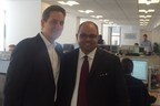Dean Curnutt, Founder and CEO of MRA, with Hector Batista, CEO of Big Brothers Big Sisters New York, who visited MRA's office on Charity Day to watch the trading in action.