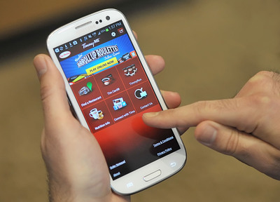 Tim Hortons Cafe & Bake Shops newly upgraded mobile application, TimmyMe, brings the previously web-based TimmyRun and Tim Card reload functions together on your mobile device.  (PRNewsFoto/Tim Hortons Inc.)