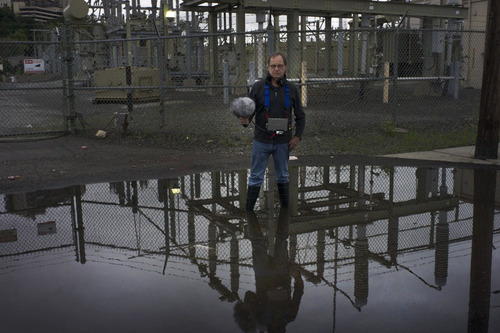BURN Host Alex Chadwick stands with his radio gear on a partly flooded street near a power plant in Hoboken, New Jersey, where he reports on the damage done by Hurricane Sandy, and the efforts of city officials to build a new, smarter grid that would ...