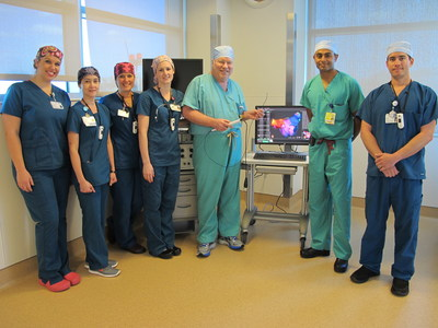 St. Joseph's Hospital team members Amanda Malone, registered cardiovascular invasive specialist (RCIS), Joan Mejia, RN, Monica Elias, cardiovascular technologist, Jennifer Monaghan, RCIS, James Irwin, M.D., Kevin Makati, M.D., and Sam Weiss, RCIS, flank the new equipment for the Rhythmia Mapping System.