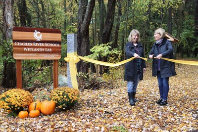 Grandparent Judy Samelson and former CRS science teacher Pam Moor officially open the Charles River School Wetlands Lab in Dover.