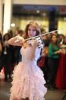 An artist playing the violin at ISMOB Furniture Fair (PRNewsFoto/TUYAP)