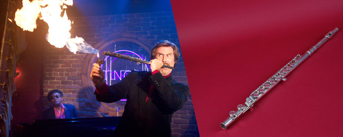 "In one of the most memorable scenes in ""Anchorman: The Legend of Ron Burgundy,"" Ron (Will Ferrell) ignites his flute during an impromptu jazz performance. The flute will be part of ""Anchorman: The Exhibit,"" opening at the Newseum Nov. 14.  (PRNewsFoto/Newseum, Courtesy Paramount Pictures; Flute: Sarah Mercier/Newseum/Courtesy DreamWorks Studios)"
