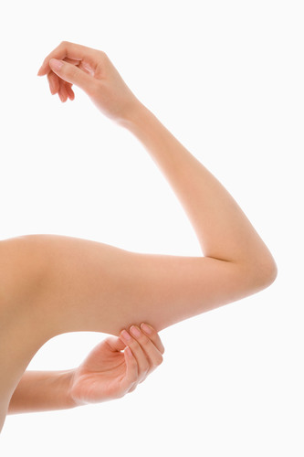 Diet and an exercise plan that includes a focus on arm muscles are the ideal paths to upper arm toning, but for  ...