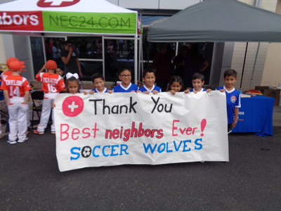 Local children's soccer teams thank the Zaragoza Neighbors Emergency Center location for their support.