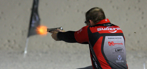 Barry Dueck, a pro shooter on team SureFire, lights up the night sky as he raced Keith Garcia to the final target. Dueck took home 2nd place honors and a $10,000 cash payday.  (PRNewsFoto/3-Gun Nation)