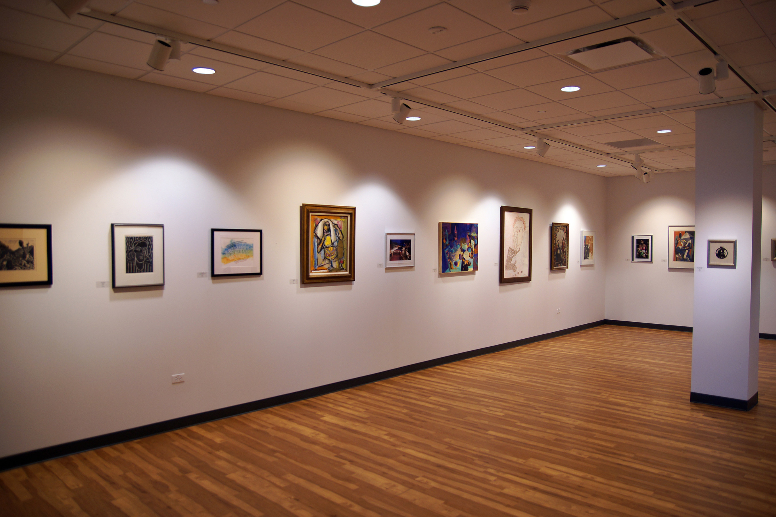 Artwork is displayed in the Fr. Michael E. Komechak, O.S.B., Art Gallery at Benedictine University. (PRNewsFoto/Benedictine University)